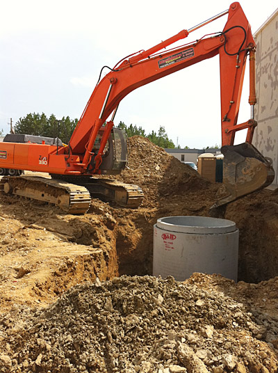 330 Excavator and 24′ deep concrete wet well